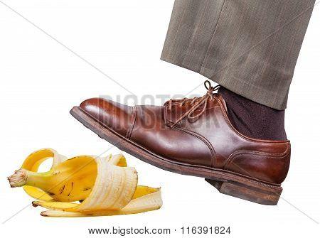 Leg In The Left Brown Shoe Slips On A Banana Peel