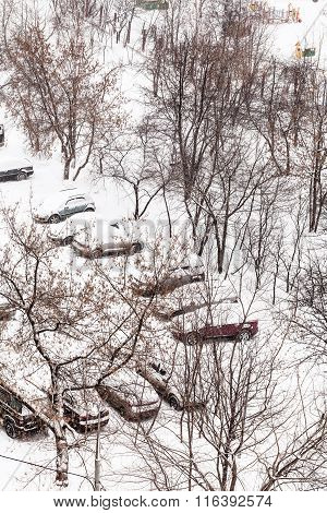 Above View Of Snow Covered Cars In Parking Lots