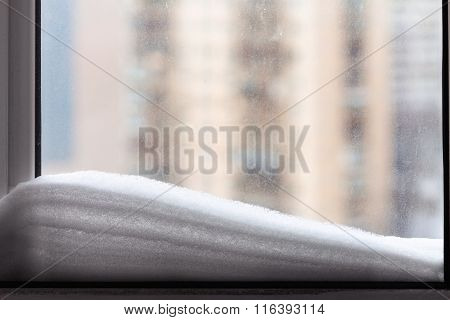 Snow On Home Window And Urban House In Winter