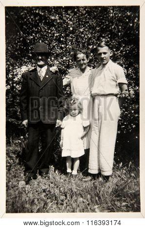 Vintage Photo: Family Posing Outdoors