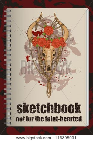 sketchbook cover with decorated animal skull