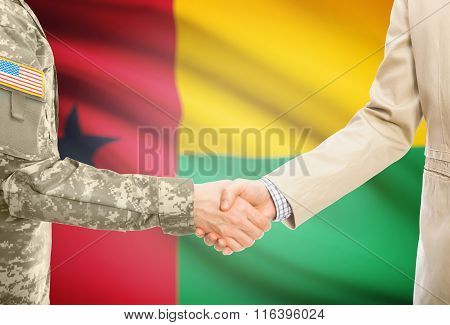 Usa Military Man In Uniform And Civil Man In Suit Shaking Hands With National Flag On Background - G
