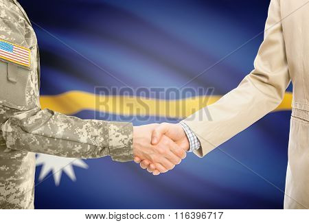 Usa Military Man In Uniform And Civil Man In Suit Shaking Hands With National Flag On Background - N