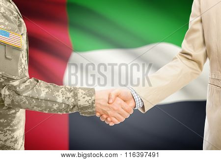 Usa Military Man In Uniform And Civil Man In Suit Shaking Hands With National Flag On Background - U