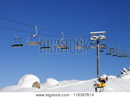 Chair-lift At Ski Resort At Sun Day After Snowfall