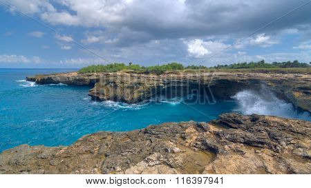 Surf On The Rocks Near The Island Of Lembongan