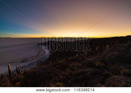 Uyuni Salt Flat On The Bolivian Andes At Dawn