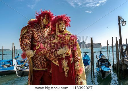 Venice carnival and gondolas