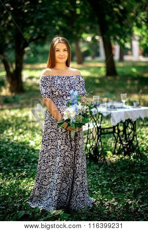 Pregnant Woman In A Dress On Nature