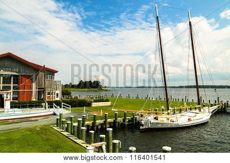Sail Boat Docked in Harbor