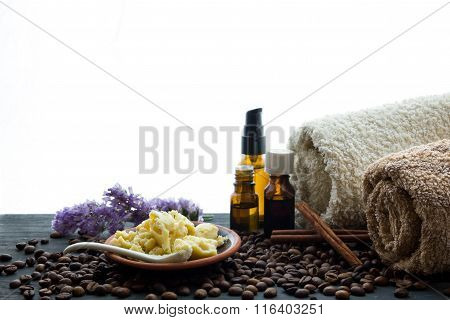Natural Organic Soap Bottles Essential Oil And Sea Salt Herbal Bath  On A Wooden Table Coffee Backgr