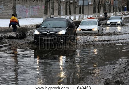 Cars In The Flooded Street