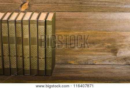 Vintage Books On A Wooden Shelf