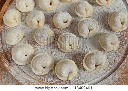 Uncooked dumplings stuffed with meat
