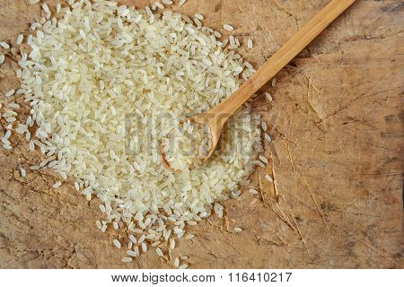 Parboiled long grain rice in a bowl with a spoon