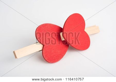 Heart-shaped clothes pins locked together