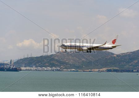 HONG KONG - JUNE 04, 2015: Air China aircraft landing at Hong Kong airport. Air China Limited is the flag carrier and one of the major airlines of the People's Republic of China.