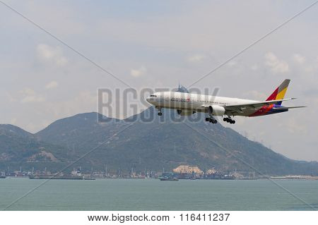 HONG KONG - JUNE 04, 2015: Asiana Airlines aircraft landing at Hong Kong airport. Asiana Airlines Inc. is one of South Korea's two major airlines, along with Korean Air