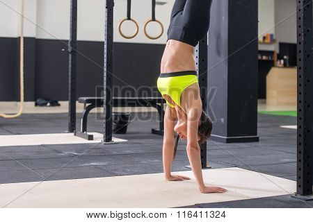 Fit woman doing a handstand concept balance sport fitness lifestyle and people