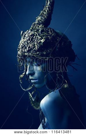 Blue woman in original headwear