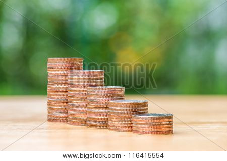 Stack Of Coin On Wood Table And Blur Background