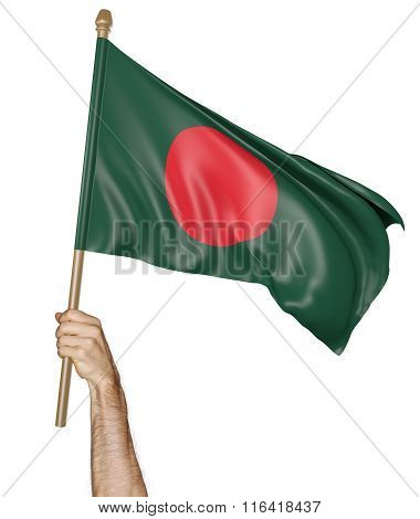Hand proudly waving the national flag of Bangladesh
