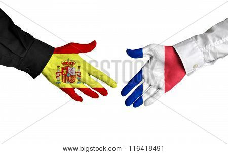 Spain and France leaders shaking hands on a deal agreement