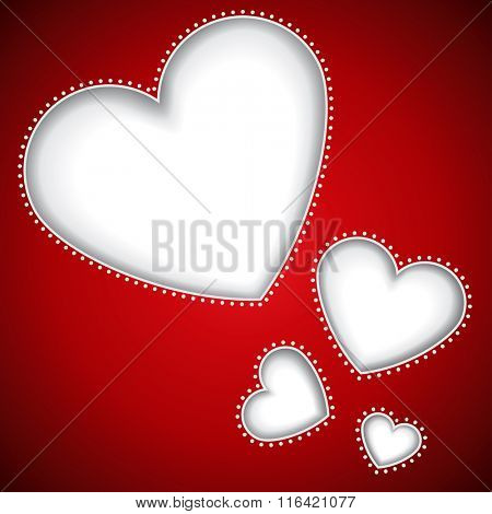 Cut heart shapes red background with copy space.