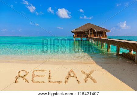Word Relax on beach - nature holiday background
