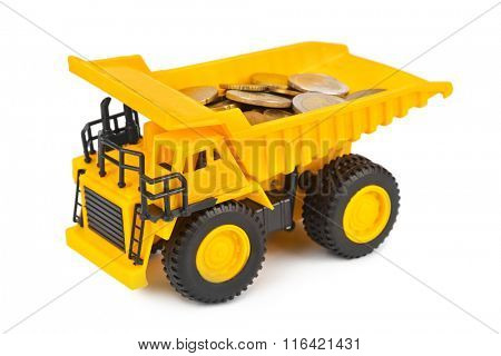 Toy car truck with money coins isolated on white background