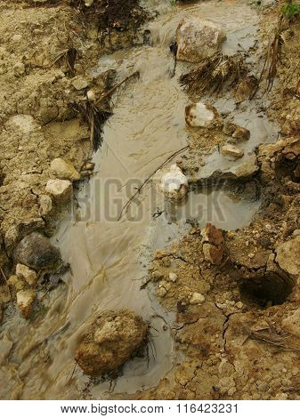 Severe oil pollution contaminates soil and water at an illegal oil mine in Java, Indonesia