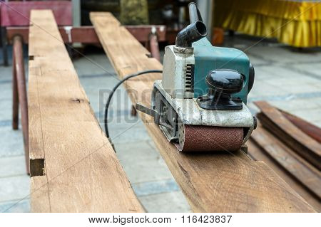 Planing Machine On Wooden Plank.