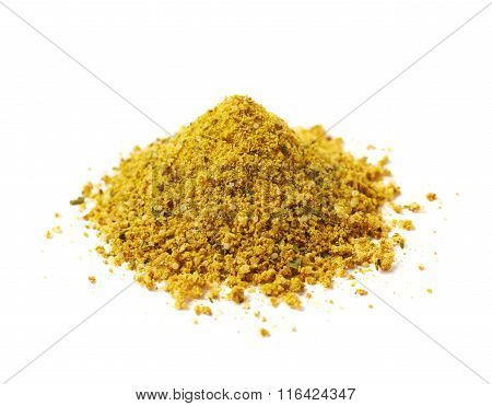 Pile of yellow curry seasoning isolated