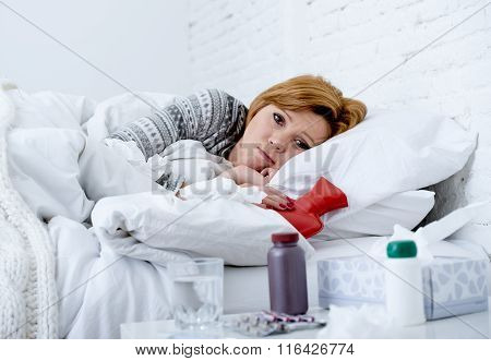 Young Sick Woman Lying On Bed Ill Feeling Bad Looking Feverish And Weak Suffering Winter Flu Virus