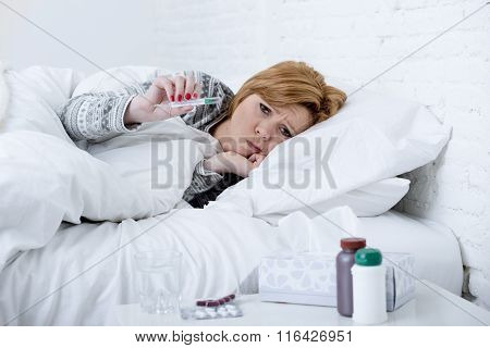 Sick Woman In Bed Checking Temperature With Thermometer Feeling Feverish Having Cold Winter Flu Viru