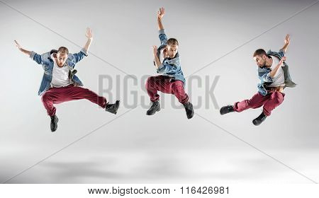 Three hip hop dancers on studio background