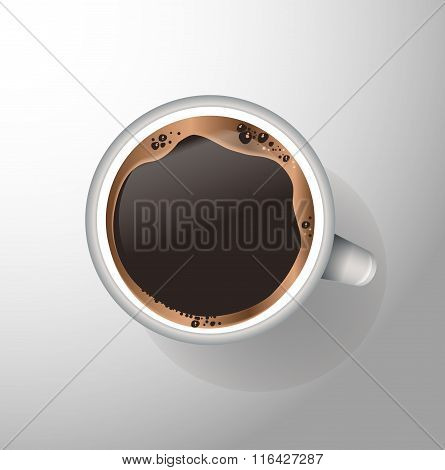 White mug of coffee with foam and sauce