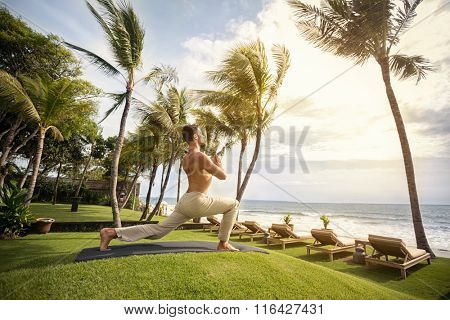 Man practicing yoga in nature,  balance of mind and body