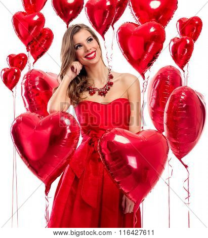 Cute beautiful young woman in love surrounded by red hearts