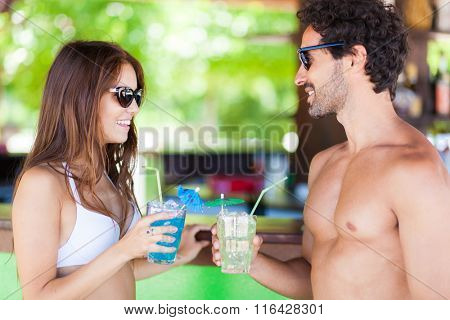 Young people talking in a beach bar