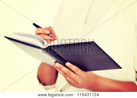 Young businesswoman makes a notes