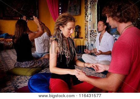 Couples perform tantric yoga during a tantric yoga therapy session in Ubud, Bali