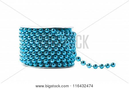 Small beads garland thread on a reel