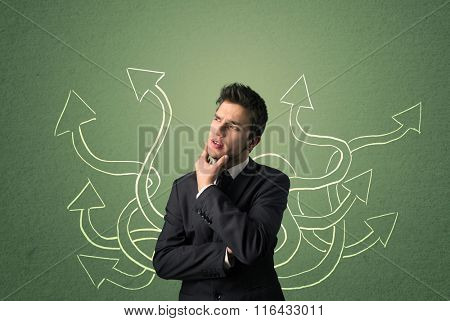 Young Businessman with thoughtful expression with tangled arrows coming out of his back