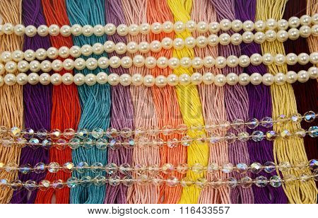 Multi-colored yarns. Floss with beautiful multicolored pearls and glass beads brilliant,creative and