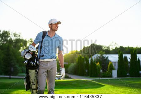 Young man with a golf bag