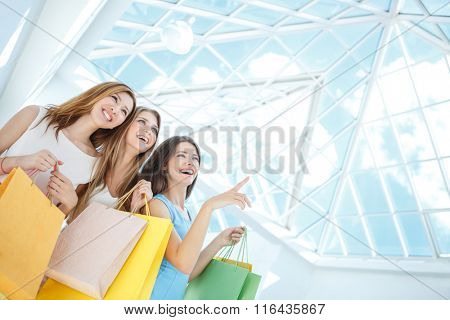 Beautiful girls with shopping bags in store