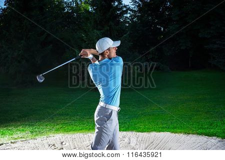 Young man playing golf outdoors