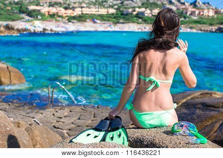 Young woman with equipment ready for snorkeling