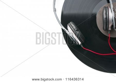 headphones and vinyl record on white background